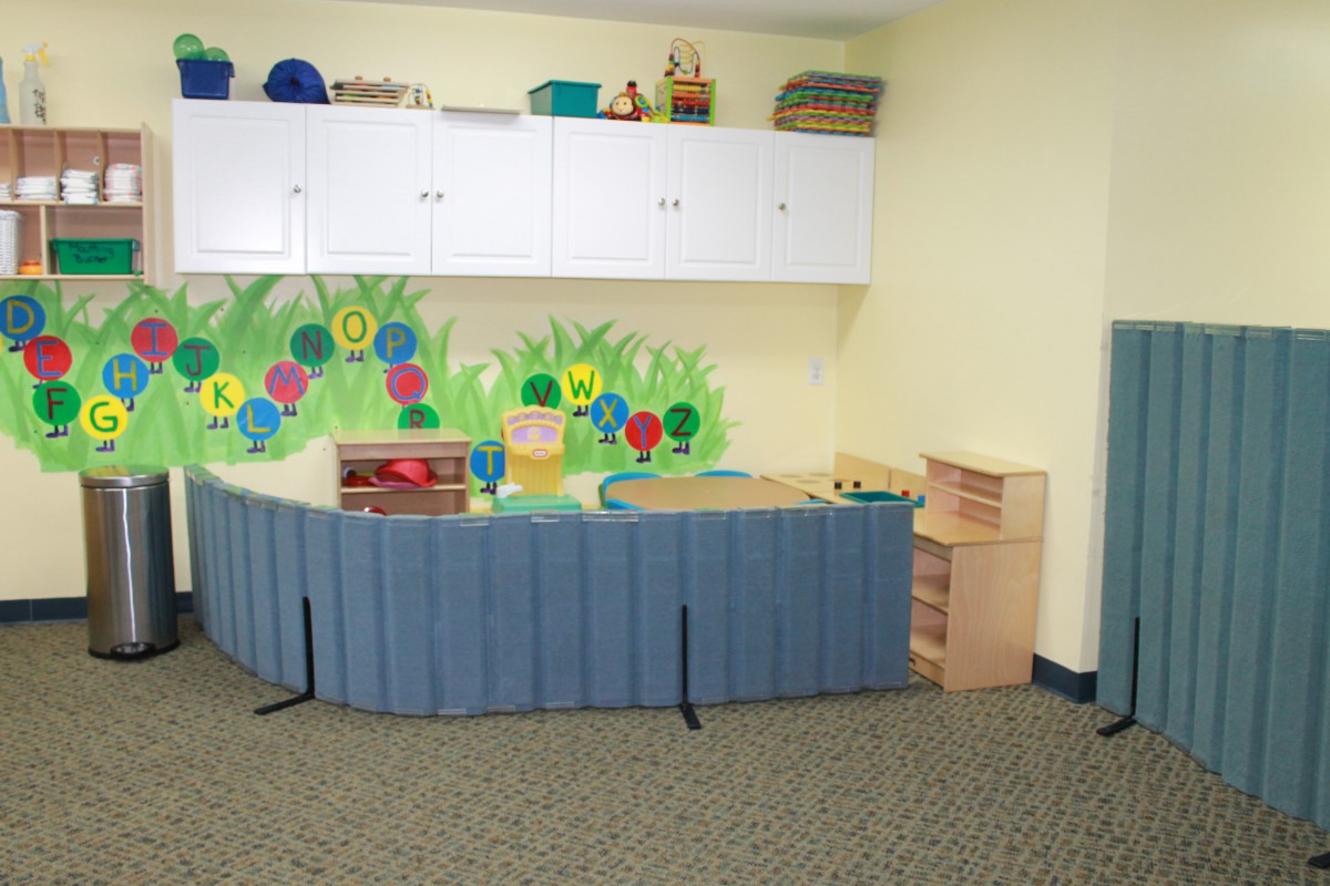 preschool classroom with ABCs painted on the wall